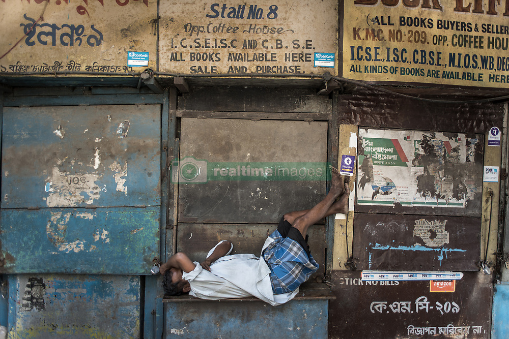 A man sleeps in the afternoon on the bench of a book store at a lane in college street in Kolkata. College street is the largest book market in the country and is one of the most important and recognised places in the city. India is going through the 2nd phase of lockdown due to covid 19 pandemic. This is to curb the spread of Covid 19 in the country. The second phase is handled with more strict rules by the administration. Kolkata, West Bengal, India, April 19, 2020. Photo by Arindam Mukherjee/ABACAPRESS.COM
