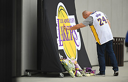 File photo of A Los Angeles Lakers fan touches a memorial for Kobe Bryant outside the Lakers practice facility on Sunday, Jan. 26, 2020 in El Segundo, Calif. (Wally Skalij/Los Angeles Times)