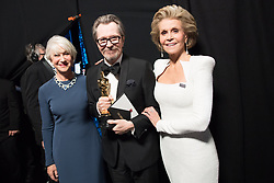 March 4, 2018 - Hollywood, California, U.S. - GARY OLDMAN poses backstage with the Oscar for performance by an actor in a leading role, for work on Darkest Hour with HELEN MIRREN and JANE FONDA during the live ABC Telecast of The 90th Oscars at the Dolby Theatre in Hollywood. (Credit Image: ? Matt Petit/AMPAS via ZUMA Wire/ZUMAPRESS.com)