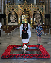 NEWS EDITORIAL USE ONLY. NO COMMERCIAL USE. NO MERCHANDISING, ADVERTISING, SOUVENIRS, MEMORABILIA or COLOURABLY SIMILAR. Reverend Anthony Ball, Canon of Westminster in Westminster Abbey in London with Toby Wright, son of the Reverend Paul Wright, Sub-Dean of the Chapel Royal, who brought Princess Beatrice's wedding bouquet straight from the wedding in Windsor which, like those of Royal brides, is traditionally placed on the Tomb of the Unknown Warrior.