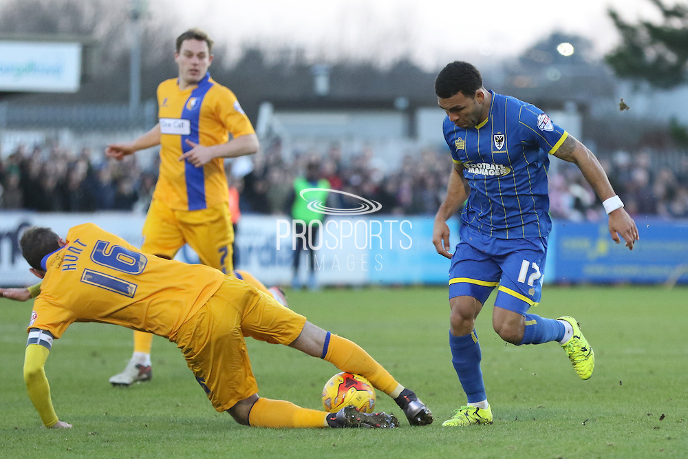 Nicky Hunt of Mansfield Town scoops the ball away from Andy Barcham of AFC Wimbledon during the Sky Bet League 2 match between AFC Wimbledon and Mansfield Town at the Cherry Red Records Stadium, Kingston, England on 16 January 2016. Photo by Stuart Butcher.