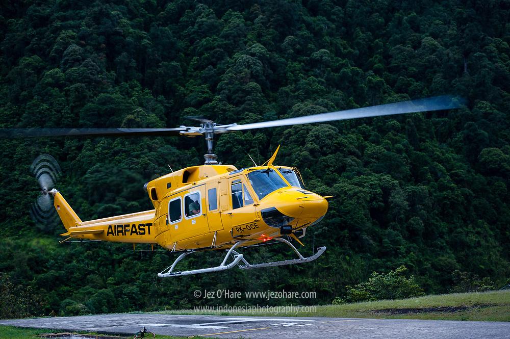 PT Freeport's Bell 212 helicopter operated by Airfast, Tembagapura helipad, Mimika, Papua, Indonesia. (Pilot Capt. Bambang Pratiknyo, Load Master Arie Polimpung)