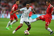 Theo Walcott of England goes past Alex Muscat of Malta. FIFA World cup qualifying match, european group F, England v Malta at Wembley Stadium in London on Saturday 8th October 2016.<br /> pic by John Patrick Fletcher, Andrew Orchard sports photography.