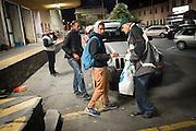 November 8, 2016 - Ventimiglia, Italy: Jean-Pierre, 70, hands out food rations to migrants in Ventimiglia, he  is a retired policeman, member of a network that helps migrants from Ventimiglia, Italy, with shelter, food and transportation.<br />  <br /> 8 novembre 2016 - Vintimille, Italie: Jean-Pierre, 70 ans, distribue des rations alimentaires aux migrants, il est un policier retraité, membre d'un réseau qui aide des migrants à Vintimille, en Italie, à abriter, nourrir et transporter.