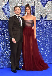 Taron Egerton (left) and Emily Thomas attending the Rocketman UK Premiere, at the Odeon Luxe, Leicester Square, London.