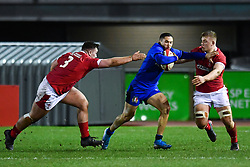 Jacopo Trulla of Italy evades the tackle of Ben Warren of Wales <br /> <br /> Photographer Craig Thomas/Replay Images<br /> <br /> U20 Six Nations - Wales v Italy  - Friday 31st January 2020 - Stadiwm Zip World (Parc Eirias) - Colwyn Bay<br /> <br /> World Copyright © Replay Images . All rights reserved. info@replayimages.co.uk - http://replayimages.co.uk