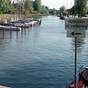 Verboden te zwemmen bord aanloophaven Huizen
