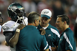 ATLANTA, GA - SEPTEMBER 18: Quarterback Michael Vick #7 of the Philadelphia Eagles holds onto trainer Rick Burkholder after getting injured during the game against the Atlanta Falcons at the Georgia Dome on September 18, 2011 in Atlanta, Georgia . (Photo by Drew Hallowell/Philadelphia Eagles/Getty Images) *** Local Caption ***  Michael Vick;Rick Burkholder