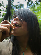 Emiliana eating Palm fruit, Going foraging with Roxana Nate and her siblings, in the jungle.