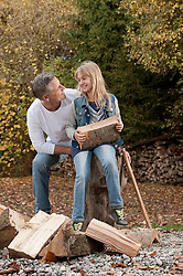 Father and daughter chopping wood