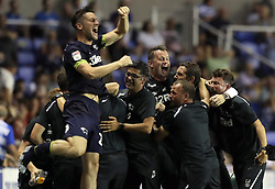 Derby County manager Frank Lampard (centre right), goalkeeping coach Shay Given (centre) and the rest of the bench celebrate after Tom Lawrence (not pictured) scores his side's second goal of the game during the Sky Bet Championship match at the Madejski Stadium, Reading.