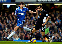 Photo: Ed Godden/Sportsbeat Images.<br />Chelsea v Wigan Athletic. The Barclays Premiership. 13/01/2007. Chelsea's Frank Lampard (L), challenges Josip Skoko.