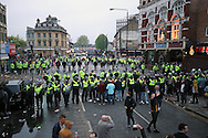 Police Line pushing the West Ham United fans back outside Boleyn Ground.scenes around the Boleyn Ground, Upton Park in East London as West Ham United play their last ever game at the famous ground before their move to the Olympic Stadium next season. Barclays Premier league match, West Ham Utd v Man Utd at the Boleyn Ground in London on Tuesday 10th May 2016.<br /> pic by John Patrick Fletcher, Andrew Orchard sports photography.
