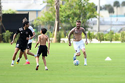 A Shirtless David Beckham is all smiles amid coronavirus fears as he plays a soccer match with family and friends inside his empty MLS stadium on what would have been the home opener. 14 Mar 2020 Pictured: David Beckham. Photo credit: MEGA TheMegaAgency.com +1 888 505 6342