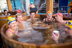 © Licensed to London News Pictures. 28/01/2017. London, UK. The 7th UK Cold Water Swimming Championships take place at Tooting Bec Lido. Ice in the Lido has only recently thawed following freezing temperatures in London over the past week. Photo credit : Tom Nicholson/LNP