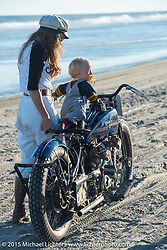 Brittney Olsen lets baby Lock play on the One of One Harley-Davidson (built by her husband Matt Olsen) at The Race of Gentlemen. Wildwood, NJ, USA. October 11, 2015.  Photography ©2015 Michael Lichter.