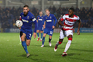 AFC Wimbledon midfielder Scott Wagstaff (7) chasing a through ball during the The FA Cup match between AFC Wimbledon and Doncaster Rovers at the Cherry Red Records Stadium, Kingston, England on 9 November 2019.