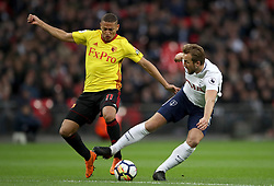 Watford's Richarlison (left) and Tottenham Hotspur's Harry Kane battle for the ball during the Premier League match at Wembley Stadium. London.