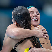 TOKYO, JAPAN - JULY 27: Kaylee McKeown of Australia is hugged by team mate Emily Seebohm of Australia after winning the gold medal in the 100m backstroke for women during the Swimming Finals nat the Tokyo Aquatic Centre at the Tokyo 2020 Summer Olympic Games on July 27, 2021 in Tokyo, Japan. (Photo by Tim Clayton/Corbis via Getty Images)
