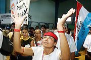 """09 SEPTEMBER 2003 - CANCUN, QUINTANA ROO, MEXICO: An indigenous Mexican woman participates in a blessing ceremony during the opening of the Forum for Indigenous People at the Casa de la Cultura in Cancun during the World Trade Organization Ministerial meetings. The indigenous forum was held as a """"trade fair"""" counterpoint to the fair trade talks going on in the Mexican resort city.   PHOTO BY JACK KURTZ"""