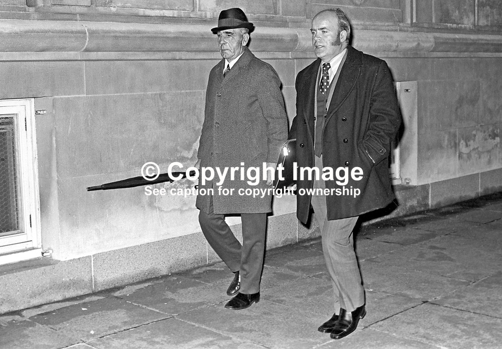 Johnny McQuade, Democratic Unionist assemblyman, left, and James Craig, Vanguard Unionist assemblyman, leaving the Stormont Parliament Building after being involved in fighting during which two Ulster Unionist assemblymen, Herbert Kirk, finance minister, and Peter McLachlan, were injured. McQuade was a former professional boxer who fought under the name, Jack Higgins. 197312050748a.<br /> <br /> Copyright Image from Victor Patterson, Belfast, UK<br /> <br /> t: +44 28 9066 1296 (from Rep of Ireland 048 9066 1296)<br /> m: +44 7802 353836<br /> e: victorpattersonbelfast@gmail.com<br /> <br /> www.images4media.com<br /> <br /> Please see my full Terms and Conditions of Use at https://www.images4media.com/p/terms-conditions - it is IMPORTANT that you familiarise yourself with them.<br /> <br /> Images used online incur an additional cost. This cost should be agreed in writing in advance. Online images must be visibly watermarked i.e. © Victor Patterson or that of the named photographer within the body of the image. The original metadata must not be deleted from images used online.<br /> <br /> This image is only available for the use of the download recipient i.e. television station, newspaper, magazine, book publisher, etc, and must not be passed on to a third party. It is also downloaded on condition that each and every usage is notified within 7 days to victorpattersonbelfast@gmail.com.<br /> <br /> The right of Victor Patterson (or the named photographer) to be identified as the author is asserted in accordance with The Copyright Designs And Patents Act (1988). All moral rights are asserted.