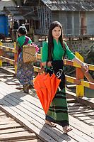 INLE LAKE, MYANMAR - DECEMBER 09, 2016 : woman walking in tradional costume at Inle Lake Shan state in Myanmar (Burma)
