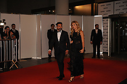 June 30, 2017 - Buenos Aires, Buenos Aires, Argentina - Soccer player Ezequiel Lavezzi and his wife Yanina Screpante pose at the red carpet prior to Lionel Messi and long time sweetheart Antonella Roccuzzo's wedding party.The ceremony and party had over 250 guests that included his fellow Barcelona F.C. players, pop star Shakira, family and childhood friends. (Credit Image: © Patricio Murphy via ZUMA Wire)