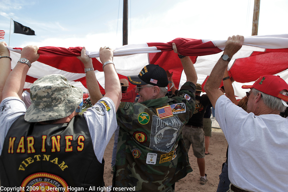 A group of Vietnam Veterans straighten a huge American flag during the Vietnam Veterans gathering in Kokomo, Indiana for the 2009 reunion.