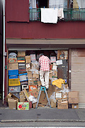 man going through his belongs stored in the downstairs garage