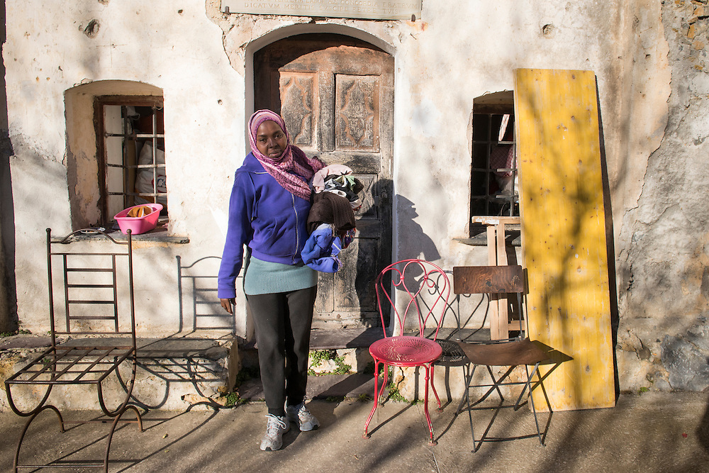December 6, 2016 - Breil-sur-Roya, France: Husna, a refugee from Sudan, in front of Francoise Cotta's house where she found shelter with her family. <br /> <br /> 6 décembre 2016 - Breil-sur-Roya, France: Husna, réfugiée soudanaise, devant la maison de Françoise Cotta où elle a trouvé refuge auprès de sa famille.