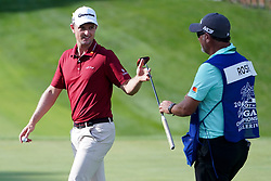 August 9, 2018 - St. Louis, Missouri, United States - Justin Rose (L) hands his putter to his caddie Mark Fulcher during the first round of the 100th PGA Championship at Bellerive Country Club. (Credit Image: © Debby Wong via ZUMA Wire)