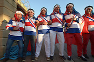 a Group of fancy dress France supporters singing outside Twickenham before k/o.Rugby World Cup 2015 pool D match, France v Italy at Twickenham Stadium in London on Saturday 19th September 2015.<br /> pic by John Patrick Fletcher, Andrew Orchard sports photography.