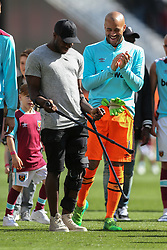 14 May 2017 - Premier League Football - West Ham United v Liverpool - Michail Antonio of West Ham jokes with West Ham goalkeeper Darren Randolph by waving his crutches around - Photo: Charlotte Wilson