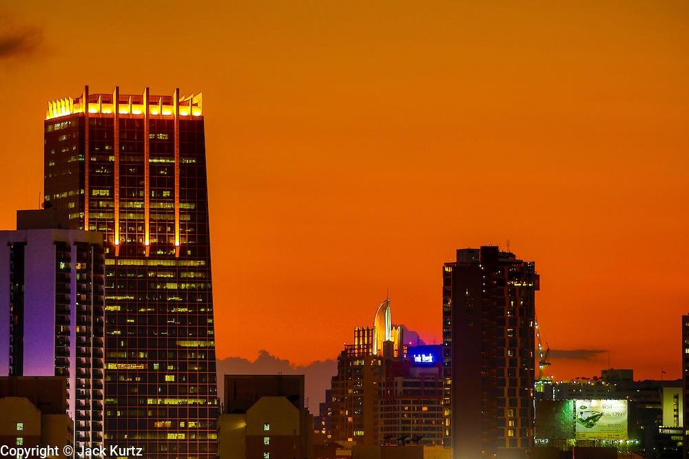 02 MAY 2013 - BANGKOK, THAILAND:   The sunsets over the city of Bangkok, the capital of Thailand.   PHOTO BY JACK KURTZ