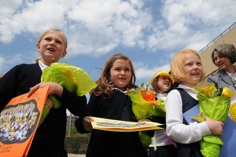 Old St. Mary's Catholic School students (l to r) Madeline Semmer, 8, Sandra O'malley, 7, Evelyn Mulchrone, 7, and Delaney Fravel, 8, listen to comments by Archbishop Francis Cardinal George made during a ground breaking ceremony at the site of the new Old St. Mary's Catholic School.