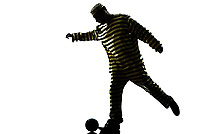 one caucasian man prisoner criminal playing soccer with chain ball in studio isolated on white background