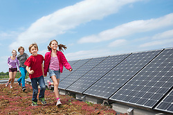 Group kids jogging solar panel park