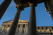 "Exterior of the Bank of England and the Corinthian columns of Rpyal Exchange on Threadneedle Street in the Square Mile, the capital's financial district, on 13th November 2017, in the City of London, England. The Bank of England, is the central bank of the United Kingdom and the model on which most modern central banks have been based. Established in 1694, it is the second oldest central bank in the world. Sir Herbert Baker's rebuilding of the Bank, demolishing most of Sir John Soane's earlier building, was described by architectural historian Nikolaus Pevsner as ""the greatest architectural crime, in the City of London, of the twentieth century""."