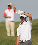 A marshal plays copycat with Gary Stal (FRA) down the 12th during Round One of the 2015 Alstom Open de France, played at Le Golf National, Saint-Quentin-En-Yvelines, Paris, France. /02/07/2015/. Picture: Golffile | David Lloyd<br /> <br /> All photos usage must carry mandatory copyright credit (© Golffile | David Lloyd)