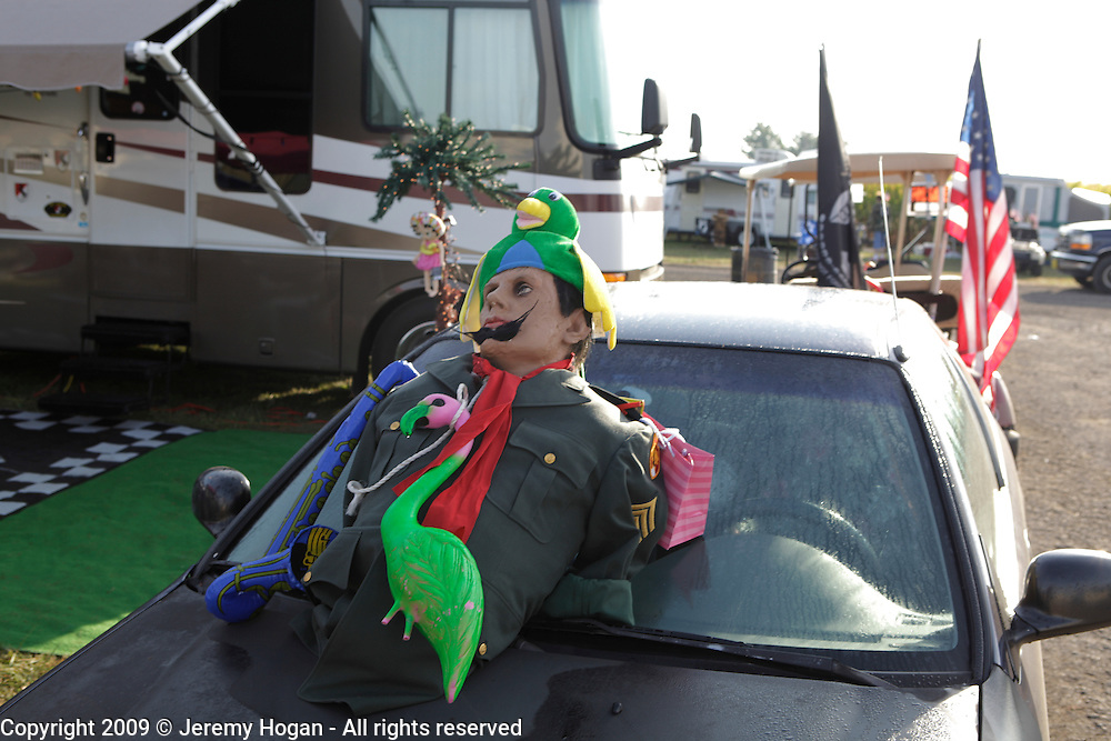 A mannequin with an army uniform sits on the hood of a car after a night of partying during the Vietnam Veterans gathering in Kokomo, Indiana for the 2009 reunion.