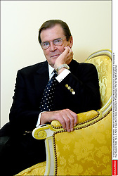 © Greg Soussan/ABACA. 42159-2. UNICEF Goodwill Ambassador Roger Moore pose for our photographer at the George V Four Seasons hotel. He is in Paris to tape the tv show Absolument 70 (Absolutely 70's) for the M6 tv channel.