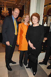 Left to right, RUPERT & CAROLINE LENDRUM he was Prince Charles's former senior equerry and LADY ELIZABETH ANSON at a fund raising evening in aid of the Royal National Lifeboat Institution at Garrard, 24 Albemarle Street, London W1 on 23rd April 2008.<br />