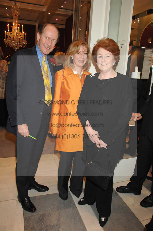 Left to right, RUPERT & CAROLINE LENDRUM he was Prince Charles's former senior equerry and LADY ELIZABETH ANSON at a fund raising evening in aid of the Royal National Lifeboat Institution at Garrard, 24 Albemarle Street, London W1 on 23rd April 2008.<br /><br />NON EXCLUSIVE - WORLD RIGHTS