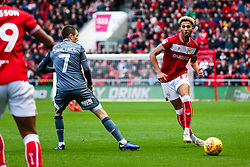 Lloyd Kelly of Bristol City is challenged by Jed Wallace of Millwall - Rogan/JMP - 02/12/2018 - Ashton Gate Stadium - Bristol, England - Bristol City v Millwall - Sky Bet Championship.