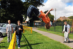 Boy performs parkour stunt at the 3BS Street Sports Project, Scunthorpe, North Lincolnshire..September 2009