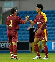 Photo: Daniel Hambury.<br />Millwall v Reading. Pre Season Friendly. 27/06/2006.<br />Reading's Seol Ki-Hyeon (L) celebrates his goal with Graeme Murty.