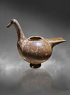 Phrygian pottery vessel in the shape of a goose decorated with geometric deigns from Gordion. Phrygian Collection, 8th century BC - Ancora Archaeological MuseumMuseum of Anatolian Civilisations Ankara. Turkey. Against a grey background .<br /> <br /> If you prefer you can also buy from our ALAMY PHOTO LIBRARY  Collection visit : https://www.alamy.com/portfolio/paul-williams-funkystock/phrygian-antiquities.html  - Type into the LOWER SEARCH WITHIN GALLERY box to refine search by adding background colour, place, museum etc<br /> <br /> Visit our CLASSICAL WORLD PHOTO COLLECTIONS for more photos to download or buy as wall art prints https://funkystock.photoshelter.com/gallery-collection/Classical-Era-Historic-Sites-Archaeological-Sites-Pictures-Images/C0000g4bSGiDL9rw