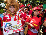 01 NOVEMBER 2015 - YANGON, MYANMAR: People go to the NLD's last election rally of the 2015  election in the Yangon suburbs Sunday. Political parties are wrapping up their campaigns in Myanmar (Burma). National elections are scheduled for Sunday Nov. 8. The two principal parties are the National League for Democracy (NLD), the party of democracy icon and Nobel Peace Prize winner Aung San Suu Kyi, and the ruling Union Solidarity and Development Party (USDP), led by incumbent President Thein Sein. There are more than 30 parties campaigning for national and local offices.    PHOTO BY JACK KURTZ