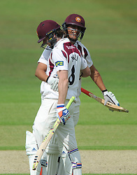 Alex Wakely of Northamptonshire celebrates with Rory Kleinveldt of Northamptonshire as he gets a century from 217 balls - Photo mandatory by-line: Dougie Allward/JMP - Mobile: 07966 386802 - 08/07/2015 - SPORT - Cricket - Cheltenham - Cheltenham College - LV=County Championship 2