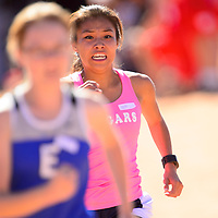 101213  Adron Gardner/Independent<br /> <br /> Alamo Navajo Cougar, Dayna Guerro, right chases down East Mountain Timberwolf Tatiana Perlinskiat, left, at the finish line during  the Zuni Invitational cross country meet in Zuni Saturday.